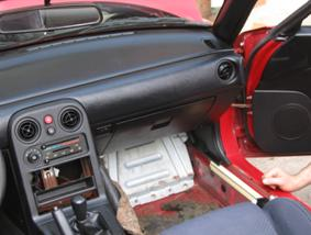 Pull back carpet to reveal the ECU cover panel.