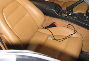 Tune cable routed by passenger seat